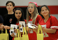 NWA Democrat-Gazette/DAVID GOTTSCHALK Alissa Castro (from right) and Eloise Kameese, Savannah Rodriguez and Luke Hudson, seventh grade students at Ramay Junior High, hold copies of The Crossover by author Kwame Alexander Thursday, October 4, 2018, during an assembly where it was announced that every seventh and eighth grade student at Ramay and Woodland Junior High in Fayetteville. The books were made possible by a gift from Tyson Charitable Giving through the Fayetteville Public Education Foundation. Alexander will be a guest speaker at True Lit: Fayetteville Literary Festival October 28 through November 4. Kikko Haydar, former University of Arkansas basketball player and student at Ramay Junior High, was the guest speaker at the assembly.