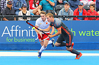 England's Christopher Griffiths and Netherlands Floris Wortelboer compete for the ball during the Hockey World League Semi-Final match between England and Netherlands at the Olympic Park, London, England on 24 June 2017. Photo by Steve McCarthy.
