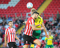 Lincoln City's Luke Waterfall vies for possession with Norwich City's Jordan Rhodes<br /> <br /> Photographer Andrew Vaughan/CameraSport<br /> <br /> Football Pre-Season Friendly - Lincoln City v Norwich City - Tuesday 10th July 2018 - Sincil Bank - Lincoln<br /> <br /> World Copyright &copy; 2018 CameraSport. All rights reserved. 43 Linden Ave. Countesthorpe. Leicester. England. LE8 5PG - Tel: +44 (0) 116 277 4147 - admin@camerasport.com - www.camerasport.com