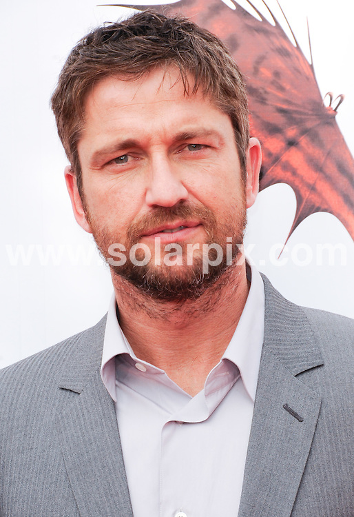 **ALL ROUND PICTURES FROM SOLARPIX.COM**.**SYNDICATION RIGHTS FOR UK, AUSTRALIA, DENMARK, PORTUGAL, S. AFRICA, SPAIN & DUBAI (U.A.E) & ASIA (EXCLUDING JAPAN) ONLY**.How To Train Your Dragon Los Angeles Premiere - Arrivals, Gibson Amphitheater / Universal City, CA. USA, 21 March 2010.This pic: Gerard Butler..JOB REF: 10945    PHZ ortega   DATE: 21_03_2010.**MUST CREDIT SOLARPIX.COM OR DOUBLE FEE WILL BE CHARGED**.**MUST NOTIFY SOLARPIX OF ONLINE USAGE**.**CALL US ON: +34 952 811 768 or LOW RATE FROM UK 0844 617 7637**