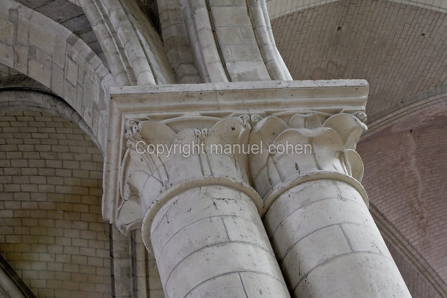SENS, FRANCE - JUNE 28 : A view from below of carved capitals in St Stephen's Cathedral, on June 28, 2008 in Sens, Burgundy, France. St Stephen's was the first Gothic Cathedral to be built in France and the architect, William of Sens, was also influential in the building of Canterbury Cathedral. Construction began c. 1135-1140, and is mainly 12th century, but was not completed until the 16th century. The capitals are carved with leaf decorations; behind them is the vaulted ceiling. (Photo by Manuel Cohen)