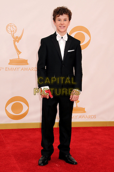 Nolan Gould<br /> 65th Annual Primetime Emmy Awards - Arrivals held at Nokia Theatre L.A. Live, Los Angeles, California, USA.<br /> September 22nd, 2013<br /> full length white black tuxedo suit  <br /> CAP/ADM/BP<br /> &copy;Byron Purvis/AdMedia/Capital Pictures