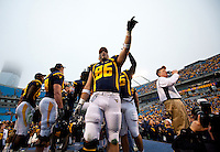 West Virginia tight end Sam Morrone (86) celebrates beating North Carolina during the Meineke Car Care Bowl college football game at Bank of America Stadium in Charlotte, NC.