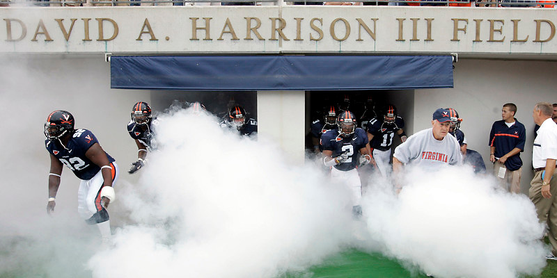 Virginia head coach al Groh, right, leads his team onto the field at the start of the game. photo/Andrew