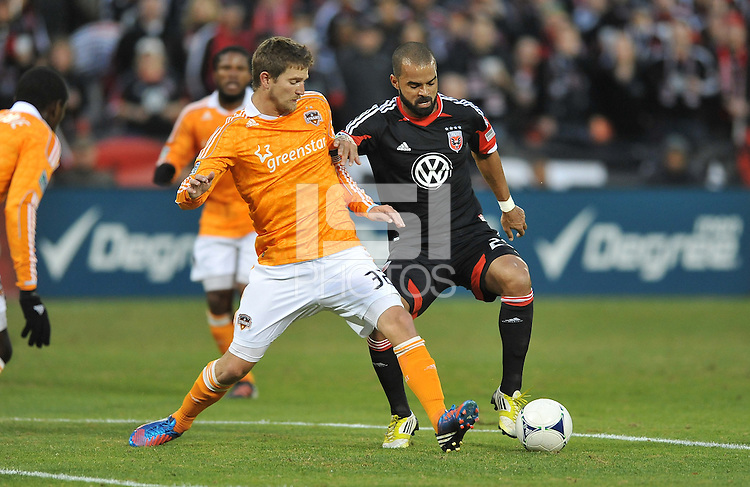 D.C. United forward Santos Maicon (29) goes against Houston Dynamo defender Bobby Boswell (32) D.C. United tied The Houston Dynamo 1-1 but lost in the overall score 4-2 in the second leg of the Eastern Conference Championship at RFK Stadium, Sunday November 18, 2012.