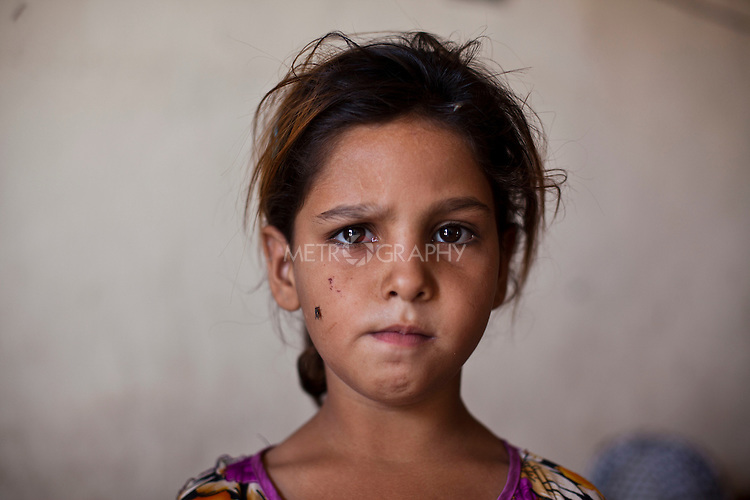 ABU AL-NRSI, IRAQ: Hania's father was killed in Fallujah during the sectarian violence...Dozens of families displaced by years of violence have been forced to return to the district of Chebaish...Photo by Ali Arkady/Metrography