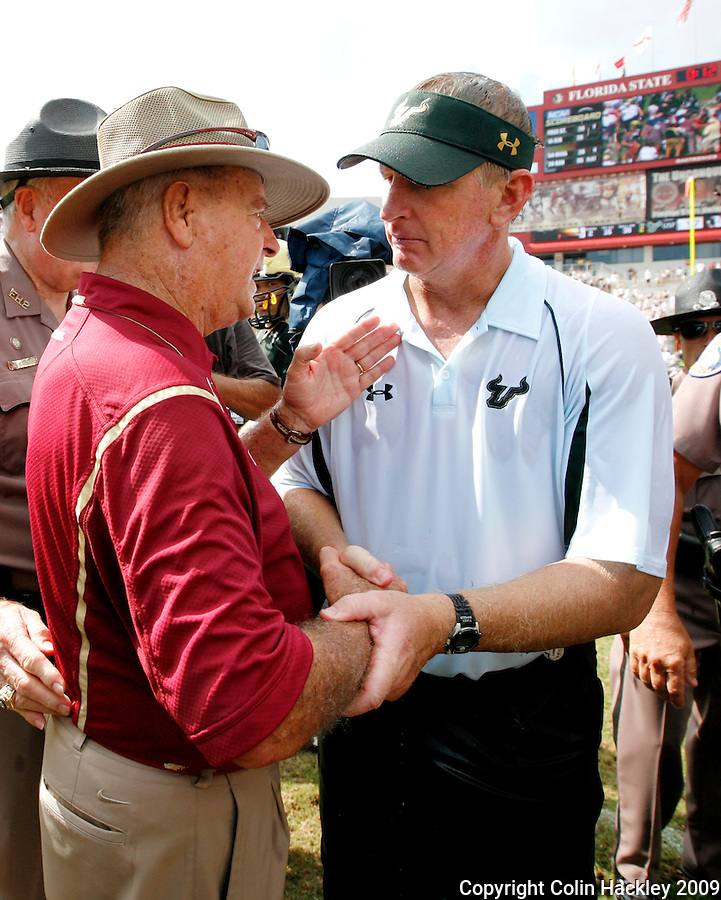 TALLAHASSEE, FL 9/26/09-FSU-USF FB09 CH21-Florida State Head Coach Bobby Bowden, left, congratulates South Florida Head Coach Jim Leavitt after the Bulls beat the Seminoles 17-7 Saturday at Doak Campbell Stadium in Tallahassee. ..COLIN HACKLEY PHOTO
