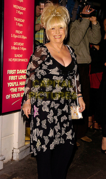 "BARBARA WINDSOR.At the World Premiere of ""Dirty Dancing: The Classic Story On Stage"", Aldwych Theatre, London, UK..October 24th, 2006.Ref: CAN.half length black and white butterfly print pattern sheer top dress.www.capitalpictures.com.sales@capitalpictures.com.©Can Nguyen/Capital Pictures"