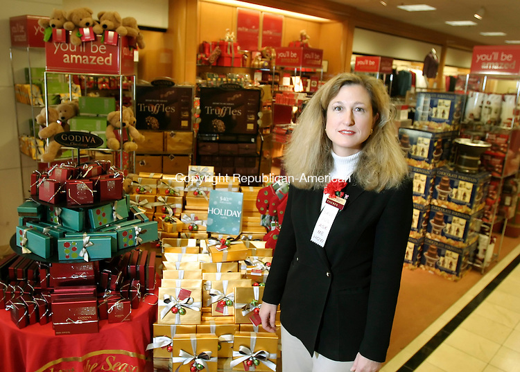WATERBURY, CT 30 November 2005 -113005BZ01- Nicole LoRusso, general manager, poses near the seasonal candy in the Filene's at the Brass Mill Center in Waterbury Wednesday afternoon.<br />  Jamison C. Bazinet Republican-American