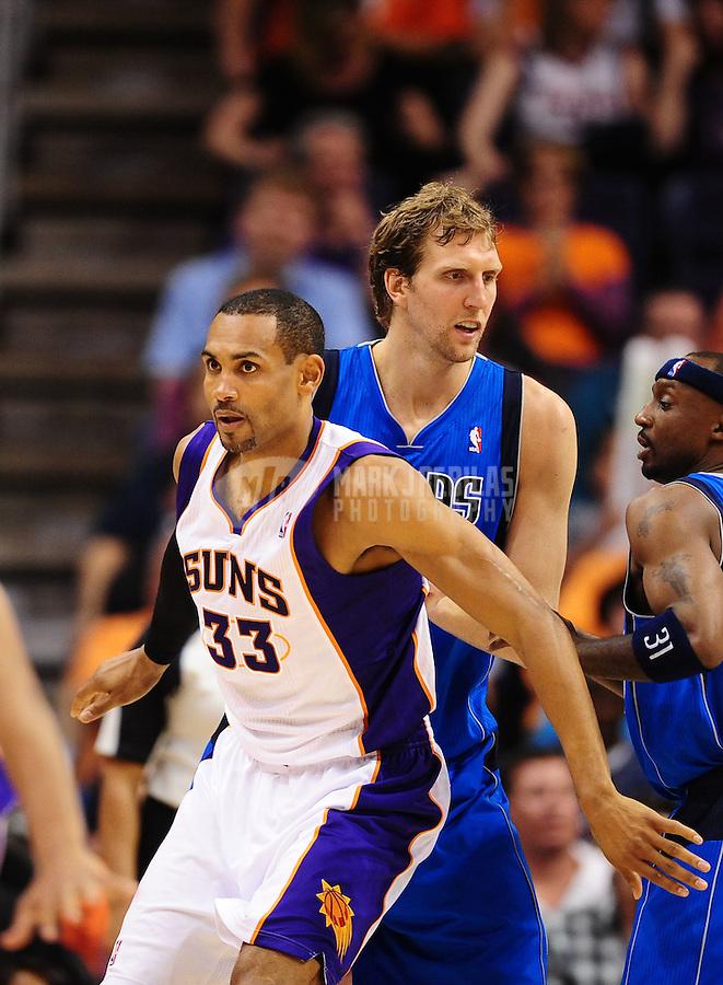 Mar. 27, 2011; Phoenix, AZ, USA; Phoenix Suns forward (33) Grant Hill against Dallas Mavericks forward (41) Dirk Nowitzki at the US Airways Center. The Maverick defeated the Suns 91-83. Mandatory Credit: Mark J. Rebilas-