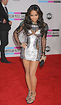 LOS ANGELES, CA. - November 21: Christina Milan arrives at the 2010 American Music Awards held at Nokia Theatre L.A. Live on November 21, 2010 in Los Angeles, California.