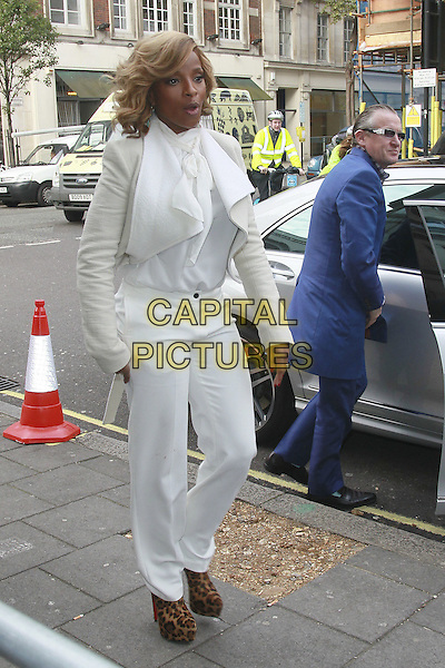 Mary J. Blige at the BBC Radio 1 studios, London, England..November 2nd, 2011.full length white cream suit trousers jacket blouse pussybow mouth open leopard print shoes platform brown.CAP/HIL.©John Hillcoat/Capital Pictures.