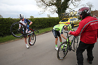 Picture by SWpix.com - 03/05/2018 - Cycling - 2018 Tour de Yorkshire - Stage 1: Beverley to Doncaster - Aritz Bagues Kalparsoro of Team EUSKADI BASQUE COUNTRY - MURIAS and Jake Stewart of Team Great Britain after a crash