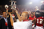 University of Wisconsin Head Coach Barry Alvarez received the John Thompson Foundation Classis Trouphy after beating Fresno State at Camp Randall Stadium in Madison, WI, on 8/23/02. The Badgers beat Fresno State 23-21.  (Photo by David Stluka)