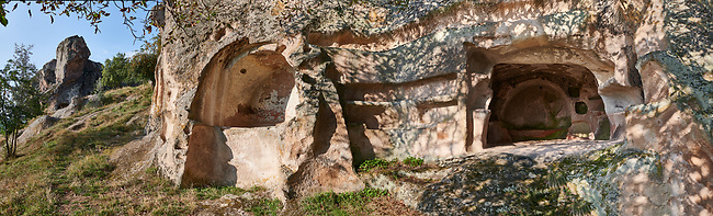 Close up of Phrygian rock tombs cut into the rocks faces protecting the citadel of Midas . From the 8th century BC . Midas City, Yazilikaya, Eskisehir, Turkey.<br /> <br /> The earliest Phrygian settlement here began in the last quarter of the 8th century BC. Even after the Phrygian kingdom collapsed politically, the city was not abandoned and the Phrygian rock structures and tombs were conserved, with some additions and changes made.in the Persian, Hellenistic, Roman and Byzantine periods.