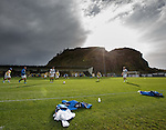 Rangers warm up before the game at the Bet Butler Stadium under Dumbarton Castle