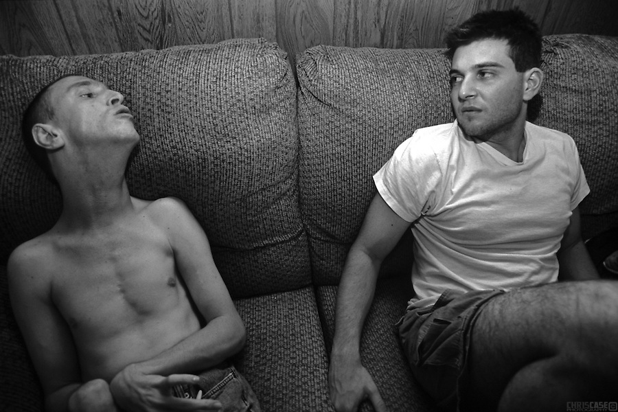 Sean Pevsner and his assistant, Michael Galante, chat while relaxing at home. <br /> Through experience, Michael has learned to interpret Sean's speech, which to the untrained ear is mostly indecipherable. <br /> <br /> Sean Pevsner was born with severe cerebral palsy. He is in his final year of law school at the University of Texas.