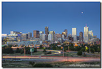 Looking east at downtown, this Denver Skyline image shows the Speer Boulevard Bridge and the Denver cityscape in the early evening. A full moon was rising in the west to enhance the sky. Denver is a vibrant city, and an escape to the Rocky Mountains is an easy drive.