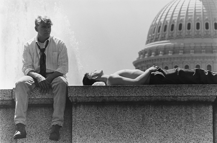 Staff members resting in front of Capitol dome. (Photo by Chris Ayers/CQ Roll Call via Getty Images)