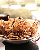 April 19, 2012. Chapel Hill, NC.. The onion straws at the Town Hall Grill at Southern Village.