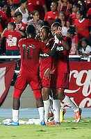 CALI - COLOMBIA - 17-02-2014: Los jugadores del America celebran a el gol anotado durante partido entre America de Cali y Bogota FC, del Torneo Postobon I 2014, jugado en el estadio Pascual Guerrero de la ciudad de Cali. / The players of America, celebrate a goal scored during a match between America of Cali y Bogota FC, of theTorneo Postobon I 2014 in the Pascual Guerrero stadium in Cali City. Photo: VizzorImage / Juan C. Quintero / Str.