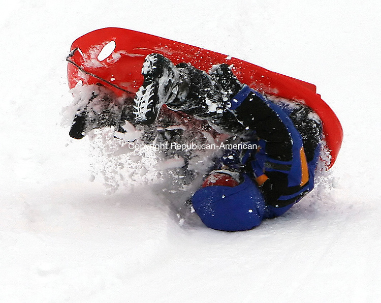 MIDDLEBURY, CT, 01/18/08- 011809BZ02- Christopher Gilbertie, 6, flips over while sledding on a hill near the Shepardson Community Center in Middlebury Sunday.<br />  Jamison C. Bazinet Republican-American