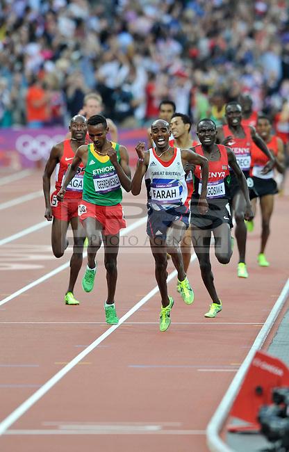 Mo Farah (GBR) wins the 5000m GOLD.Olympic Stadium.Olympic Park.Olympics 2012.London UK. .11/08/12,.photo: Sean Ryan / IPS Photo Agency.. mobile: 07971 400 939.Address: Thatched Cottage,Wretham,Thetford, Norfolk IP24 1RH .Office tel: 01953 499 403...
