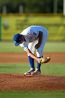 Burlington Royals starting pitcher Garrett Davila (19) cleans off the pitching rubber during the game against the Princeton Rays at Burlington Athletic Stadium on August 12, 2016 in Burlington, North Carolina.  The Royals defeated the Rays 9-5.  (Brian Westerholt/Four Seam Images)