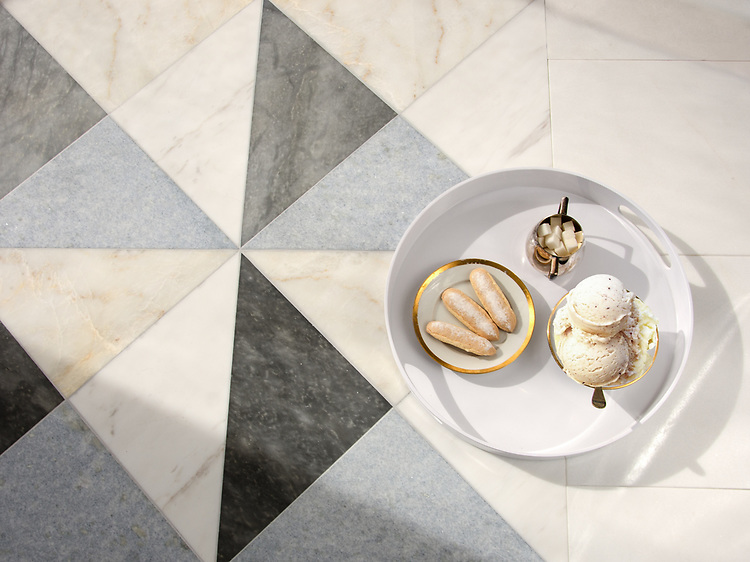 Christopher 3, a handmade mosaic shown in polished Calacatta, Cloud Nine, Celeste, and Greystoke, is part of the Illusions® Collection by New Ravenna.