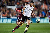 1st February 2020; Mestalla, Valencia, Spain; La Liga Football,Valencia versus Celta Vigo; Ezequiel Garay of Valencia CF brings the ball forward challenged by Gabriel Fernandez of Celta
