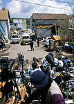 May 16, 1995, Kamikuisshiki Mura, Japan - Members of the domestic and foreign media take up their position as police raid Aum Shinriko's facility - No. 6 Satyam - on the foot of Mt. Fuji on May 16, 1995. On the morning of 20 March 1995, cult members released sarin in a coordinated attack on five trains in the Tokyo subway system, killing 13 commuters, seriously injuring 54 and affecting 980 more. Some estimates claim as many as 6,000 people were injured by the sarin. (Photo by Haruyoshi Yamaguchi/AFLO)