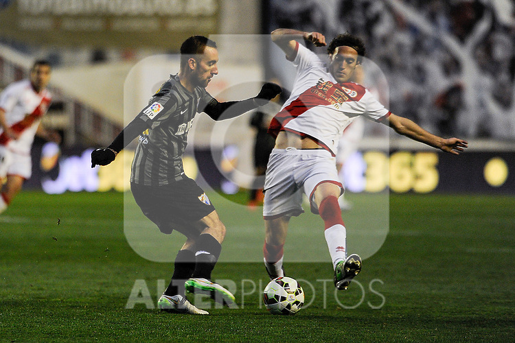 Rayo Vallecano´s Jose Raul Baena and Malaga CF´s  during 2014-15 La Liga match between Rayo Vallecano and Malaga CF at Rayo Vallecano stadium in Madrid, Spain. March 21, 2015. (ALTERPHOTOS/Luis Fernandez)