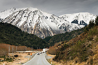 Road through high country near Porters Pass in winter, Canterbury, South Island, New Zealand, NZ