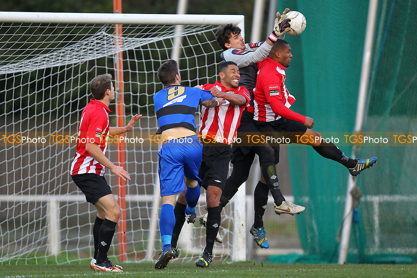 Inigo Echepare of AFC Hornchurch catches to deny Ryan Moss of Kingstonian - AFC Hornchurch vs Kingstonian - Ryman League Premier Division Football at The Stadium, Upminster Bridge, Essex - 16/11/13 - MANDATORY CREDIT: Gavin Ellis/TGSPHOTO - Self billing applies where appropriate - 0845 094 6026 - contact@tgsphoto.co.uk - NO UNPAID USE