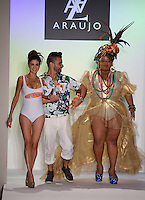 Real Housewives of Miami, Adriana De Moura, Designer AZ Araujo, and Carmen Miranda styled model with fruit hat, Polly Marinho, walk runway at A.Z Araujo Swimwear Show during Mercedes Benz IMG Fashion Swim Week 2013 at The Raleigh Hotel, Miami Beach, FL on July 23, 2012