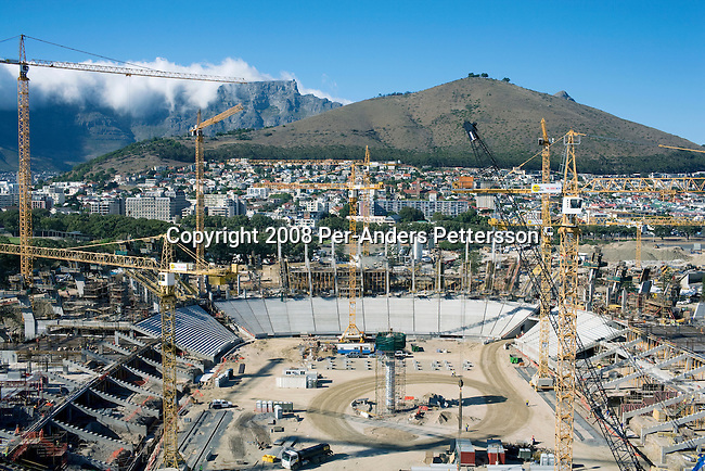 CAPE TOWN, SOUTH AFRICA - FEBRUARY 18: The construction site for the new Green Point Stadium on February 18, 2008 Green point in Cape Town, South Africa. About 1500 workers construct the new stadium that is built for the 2010 World Cup Soccer tournament held in South Africa. The stadium will have a retractable roof and a capacity of 68 000. (Photo by: Per-Anders Pettersson Reportage by Getty Images)..