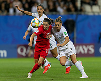 GRENOBLE, FRANCE - JUNE 15: Jessie Fleming #17 of the Canadian National Team attempts to control the ball as Ria Percival #2 of the New Zealand National Team pressures during a game between New Zealand and Canada at Stade des Alpes on June 15, 2019 in Grenoble, France.