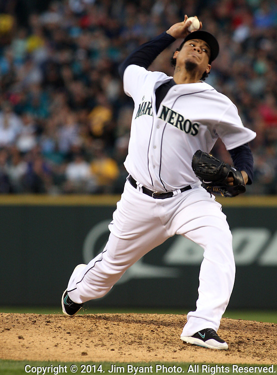 Seattle Mariners' pitcher Felix Hernandez pitches against the Oakland Athletics  September 13, 2014 at Safeco Field in Seattle.   The Athletics beat the Mariners 3-2 when Mariners pitcher Fernando Rodney  walked in Coco Crisp in the 10th inning.  ©2014. Jim Bryant Photo. All Rights Reserved.