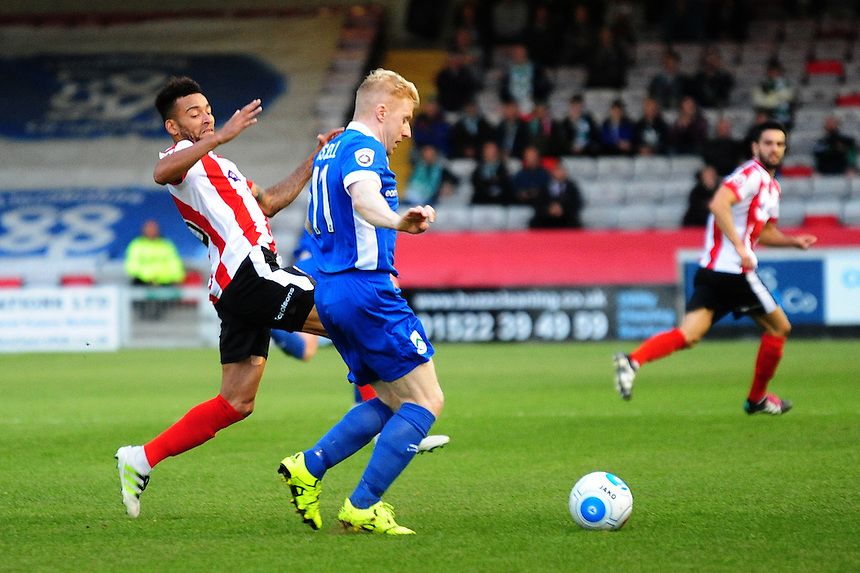 Lincoln City&rsquo;s Nathan Arnold vies for possession with North Ferriby United's Simon Russell<br /> <br /> Photographer Andrew Vaughan/CameraSport<br /> <br /> Football - Vanarama National League - Lincoln City v North Ferriby United - Tuesday 9th August 2016 - Sincil Bank - Lincoln<br /> <br /> &copy; CameraSport - 43 Linden Ave. Countesthorpe. Leicester. England. LE8 5PG - Tel: +44 (0) 116 277 4147 - admin@camerasport.com - www.camerasport.com