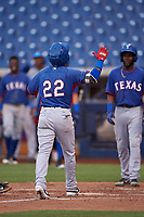 AZL Rangers Keyber Rodriguez (22) celebrates as he crosses home plate after hitting a home run during an Arizona League game against the AZL Brewers Blue on July 11, 2019 at American Family Fields of Phoenix in Phoenix, Arizona. The AZL Rangers defeated the AZL Brewers Blue 5-2. (Zachary Lucy/Four Seam Images)