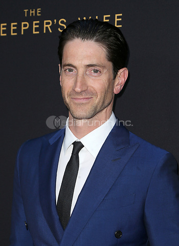 """HOLLYWOOD, CA - March 27: Iddo Goldberg, At The Premiere Of Focus Features' """"The Zookeeper's Wife""""  At The ArcLight Hollywood In California on March 27, 2017. Credit: FS/MediaPunch"""