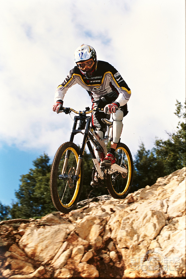 Nico Vouilloz  riding V Process bike on his home track , France 2001.      pic copyright Steve Behr / Stockfile