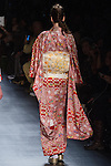 """Model walks runway in an """" Animated life"""" silk kimono from the Hiromi Asai Fall Winter 2016 """"Spirit of the Earth"""" collection by Hiromi Asai & Kimono Artisan Kyoto, presented at NYFW: The Shows Fall 2016, during New York Fashion Week Fall 2016."""
