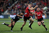 Jack Goodhue passes during the Super Rugby match between the Crusaders and Highlanders at Wyatt Crockett Stadium in Christchurch, New Zealand on Friday, 06 July 2018. Photo: Martin Hunter / lintottphoto.co.nz