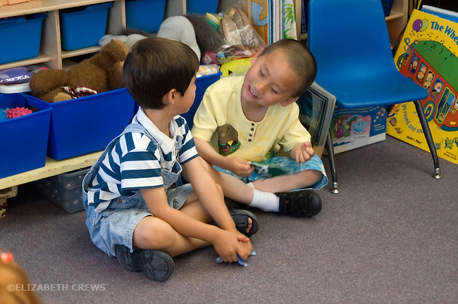 Berkeley CA Four-year-olds in sociable interaction at bilingual spanish-english preschool