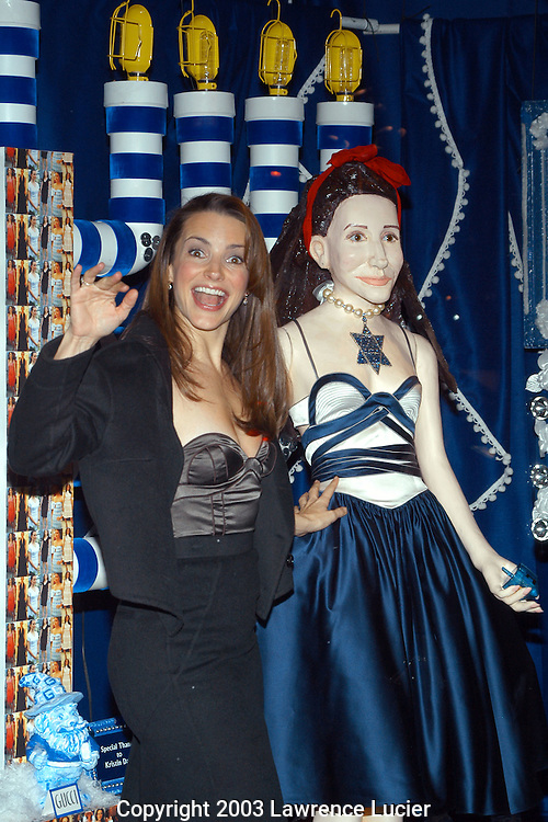 Kristin Davis and a mannequin in a dress by Proenza Schouler
