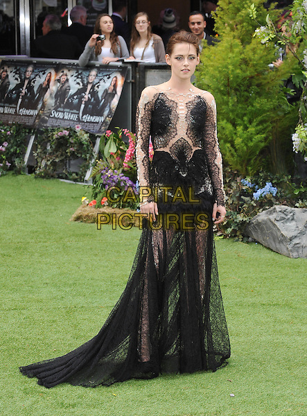 Kristen Stewart .The World Premiere of 'Snow White And The Huntsman', Empire Leicester Square, London, England..14th May 2012.full length lace black dress  .CAP/BEL.©Tom Belcher/Capital Pictures.