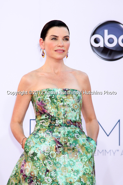 LOS ANGELES - SEP 23:  Julianna Margulies arrives at the 2012 Emmy Awards at Nokia Theater on September 23, 2012 in Los Angeles, CA