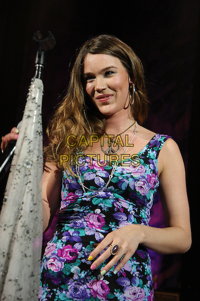 JOSS STONE.Performs live in concert at The O2 Shepherds Bush Empire, London, England, UK, March 11th 2010..Shepherd's music gig on stage half length smiling  rose floral print top vest print pink purple green  hand ring peace sign necklace nail varnish polish nails .CAP/MAR.©Martin Harris/Capital Pictures