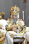 Coptic Pope Tawadros II, head of the Coptic Orthodox church, takes part in a ritual as part of a Coptic Orthodox Easter mass at the main cathedral in Cairo April 11, 2015. Photo by Amr Sayed